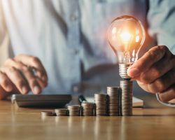 businessman hand holding light bulb. idea concept with innovation and inspiration. idea finance accounting